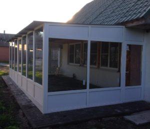 Пристройка к дому с окнами и дверьми из ПВХ