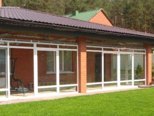 Остекление веранды раздвижными окнами ПВХ